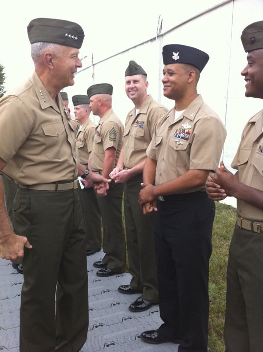 Conway with marine sharing congratulory words